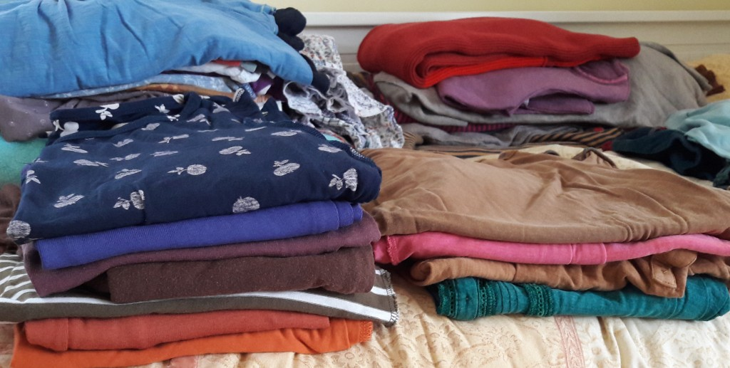 Piles of shirts and blouses on http://penspot.co.uk